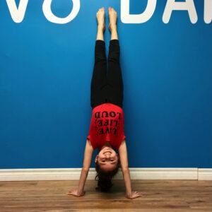 Acrobat in a handstand
