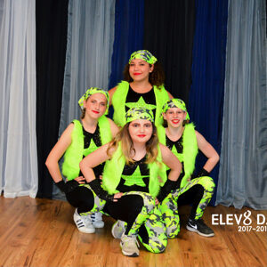 Hip hop dancers in green costumes