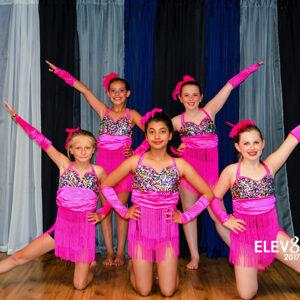Jazz dancers in pink fringe costumes